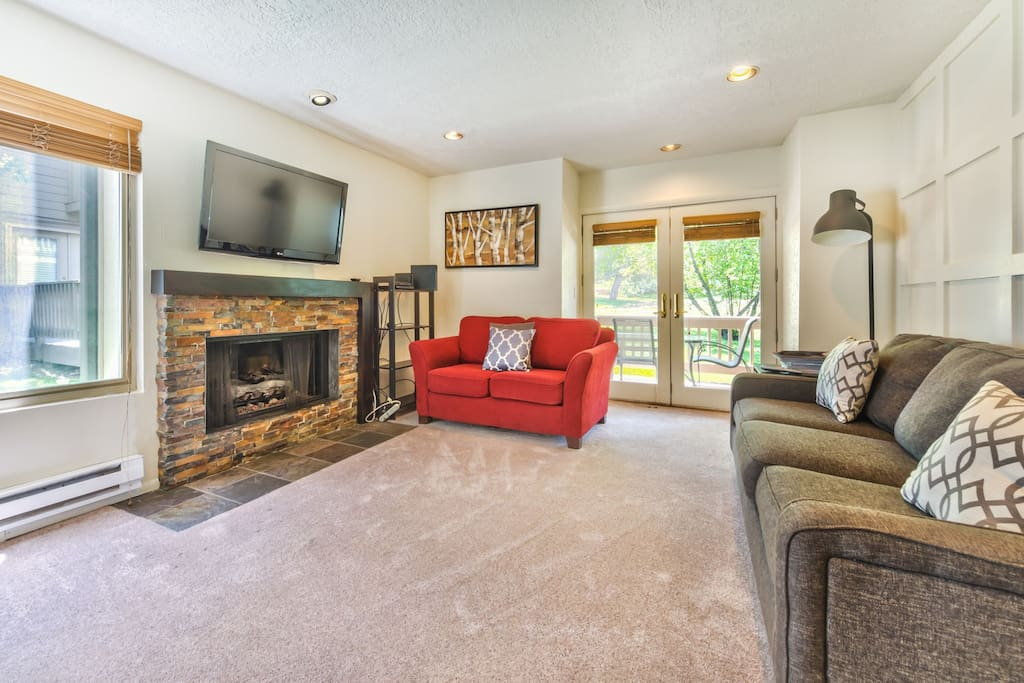 Living Area with Flat Screen TV, DVD, Gas Fireplace, Queen Sofa  Sleeper and Deck Access