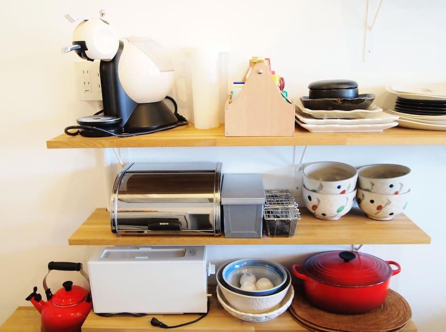 Variety of equipments; toaster, espresso machine, kettle, plates, bowls, pans, etc etc.