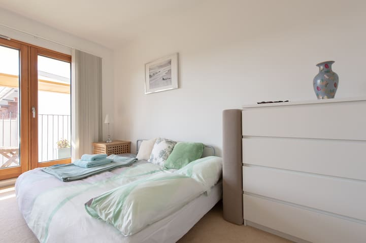 Large, double room with Muji Sofabed (Unfolded: w195 x d140 x h26cm - slightly bigger than standard double), Chest of drawers. Doors leading onto Private Balcony with Table and Two Chairs. Blackout Blinds.
