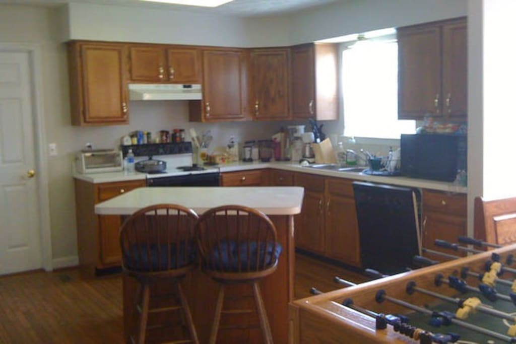 Welcoming open kitchen with all amenities.