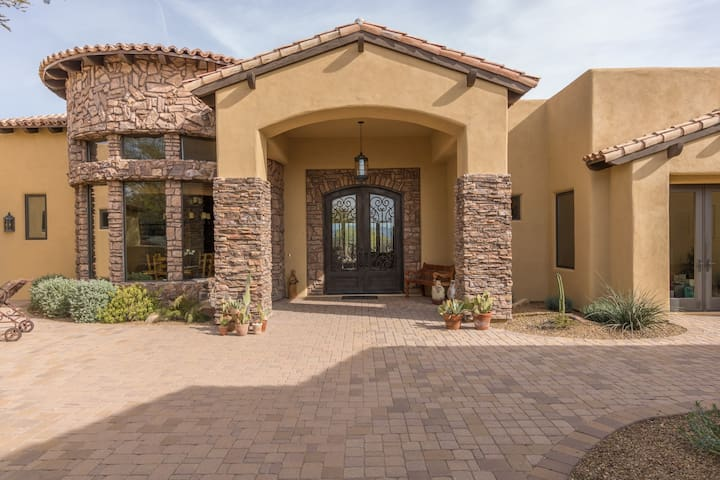 Enter through the front courtyard with lots of Tuscan stone.  A beautiful heavy iron door awaits your entry into the house