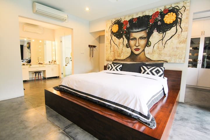Master bedroom with en suite located on the ground floor and direct pool access.