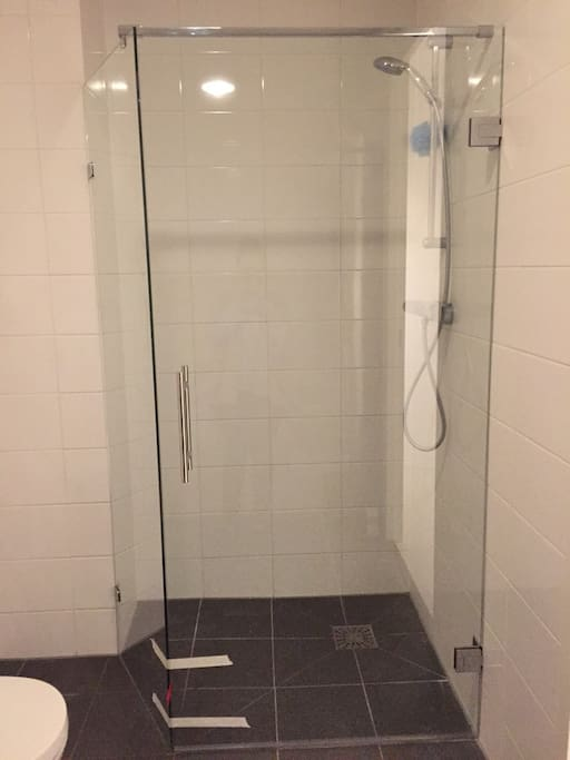 Next to a shower, there is also a bath