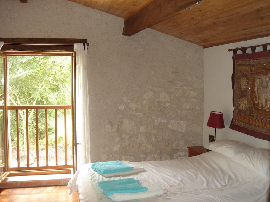 Double bedroom with views towards a 12th century church