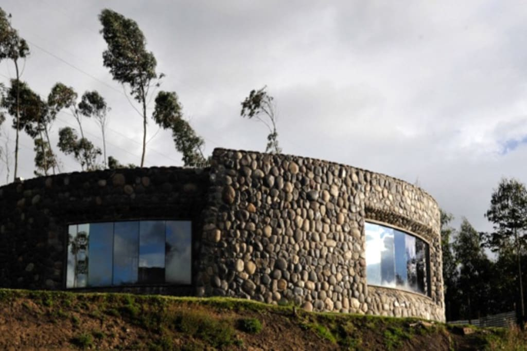 Curved stone walls keep house warm and offer great views