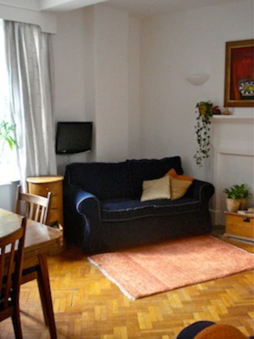 the Sitting Room with 2 double sofas and a dining table for 6