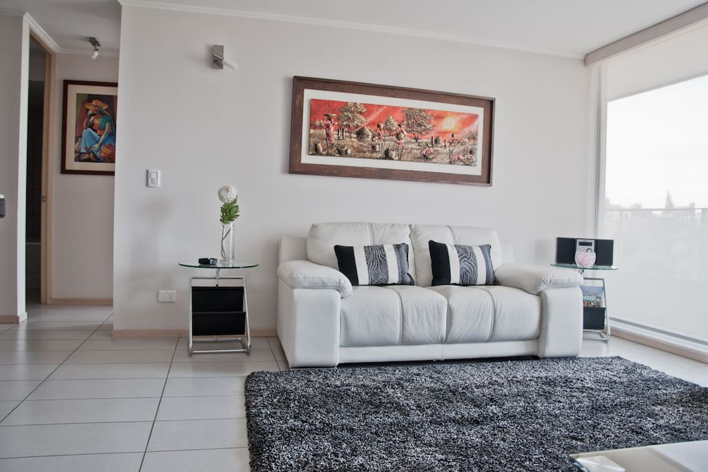 Spacious living room with cable LED Samsung Plasma 32 inches TV, with private access to balcony