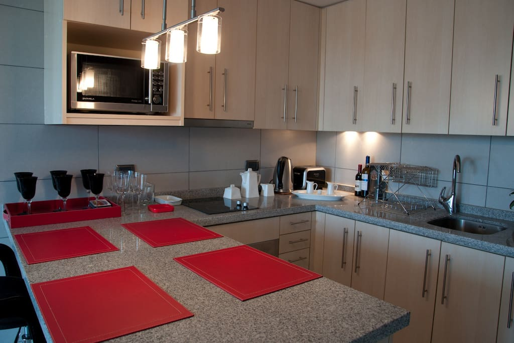Modern kitchen, with microwave, electric oven and electric stove