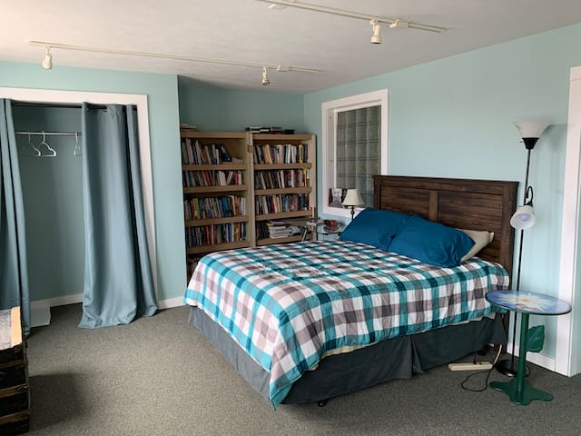 Front bedroom, also has a desk and desk chair. Overlooks Ludington Street.