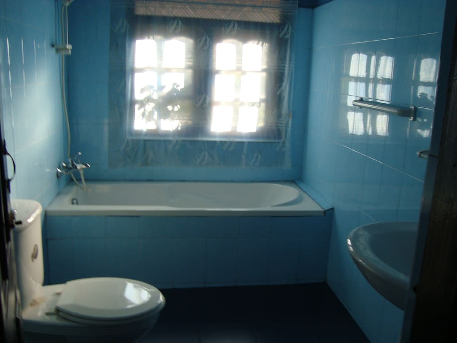 Private tiled bathroom with hot water, shower and bath tub, attached with the room No. 2