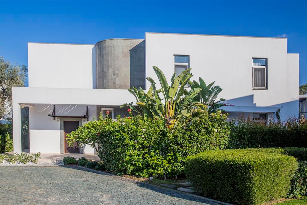 Private gardens in lush nature and open parking areas for each villa