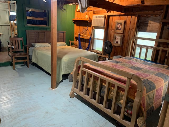 The bunk house has two queen beds plus two bunk beds.