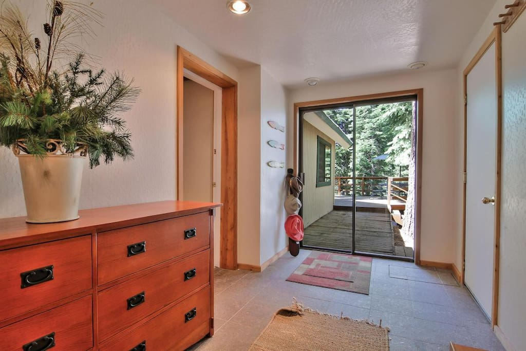 Mudroom with exit to patio, deck, and backyard