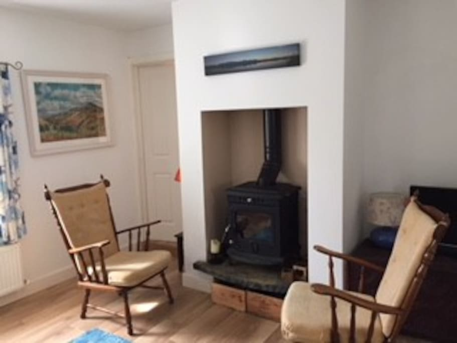 Sitting room with Stove and back boiler