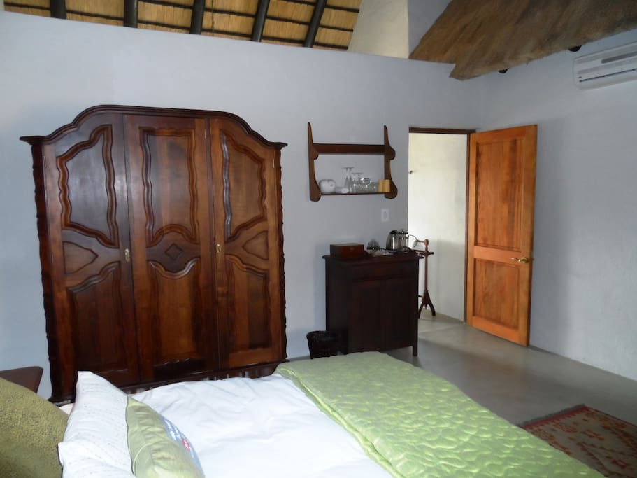 Main bedroom with Queen bed, Hospitality Tray, Minibar