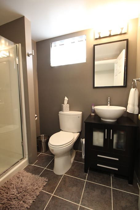 Bathroom with heated floor and modern fixtures.