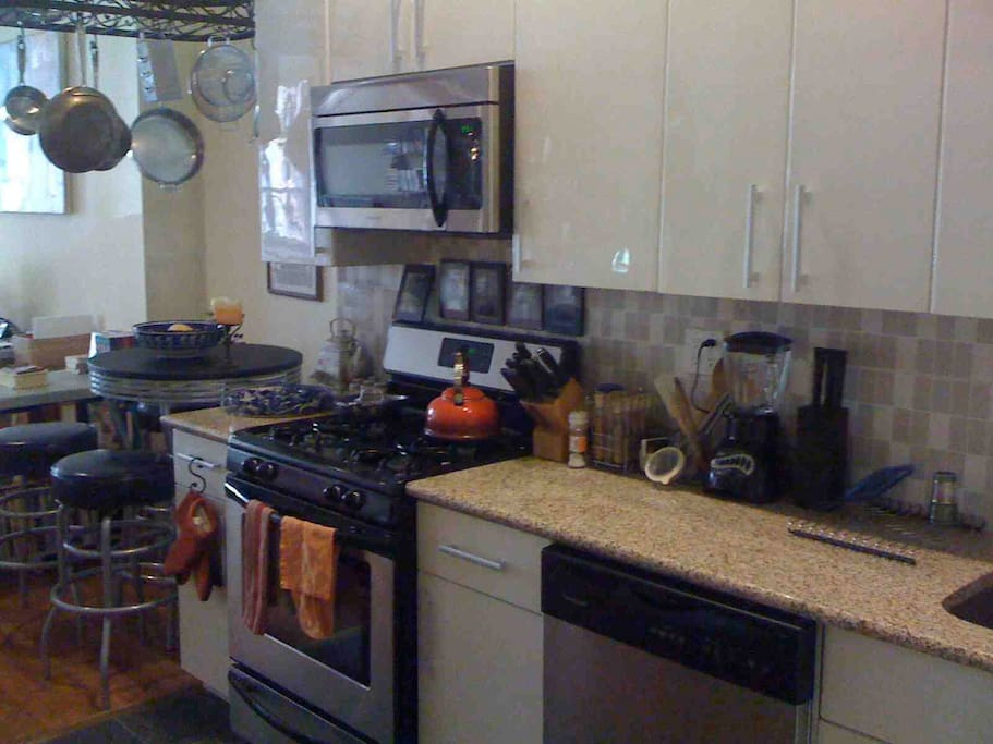 Kitchen with gas stove and dishwasher