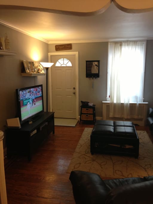 Family room with full-size sofa, love seat and ottoman