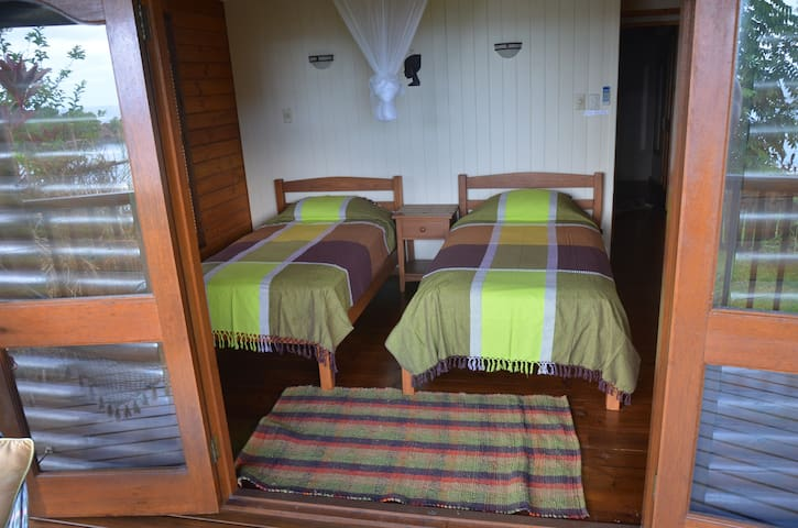 Twin bedroom with ensuite and views over the bay