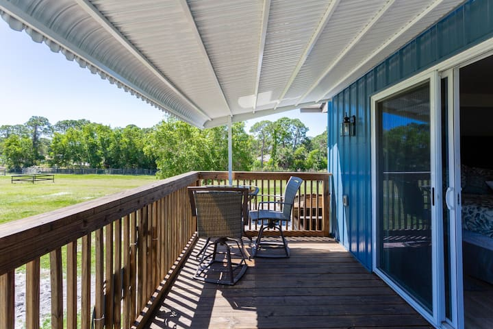 Rear deck off the master bedroom has a table with 2 chairs  where you can enjoy your morning coffee and a reclining chaise lounge for an afternoon snooze....It faces east so early birds can witness beautiful sunrises.