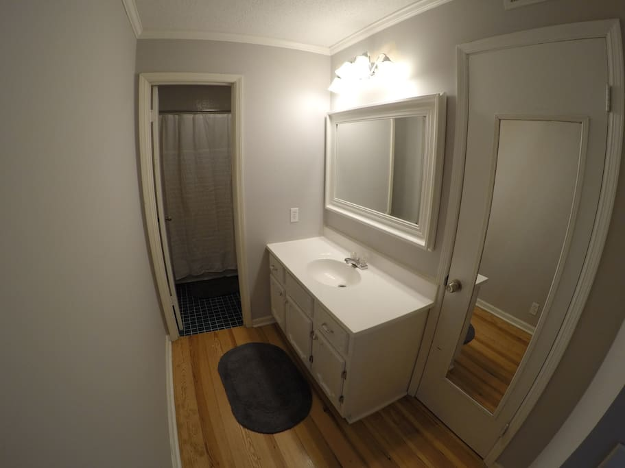 Full length mirror, walk-in closet, and sink with plenty of counter space.