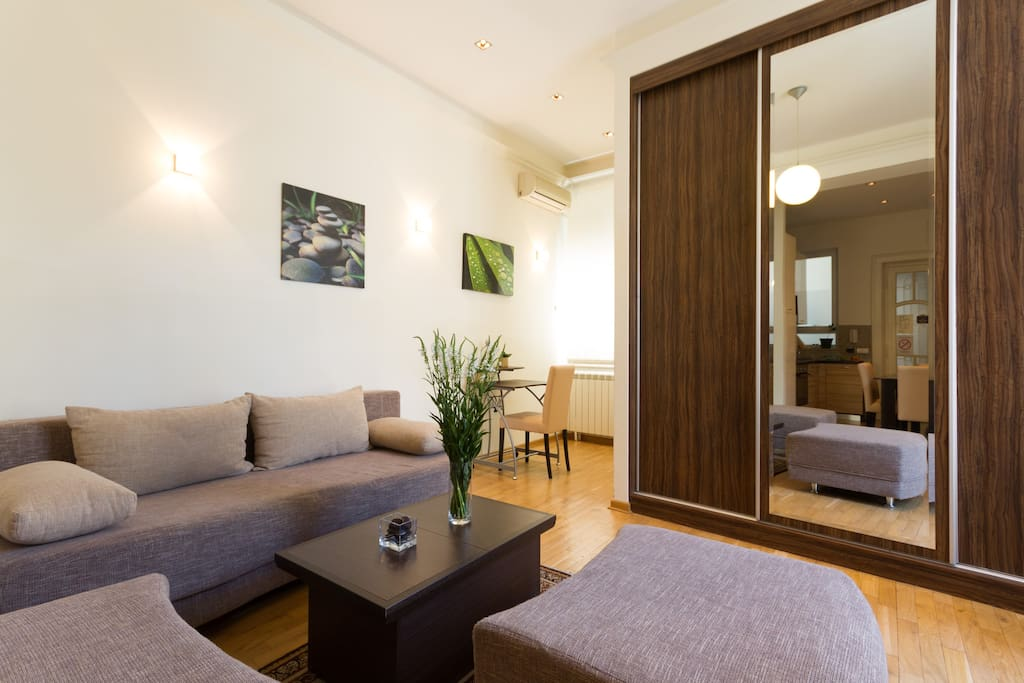 Living room is equipped with wardrobe and double sofa bed for 2 persons..