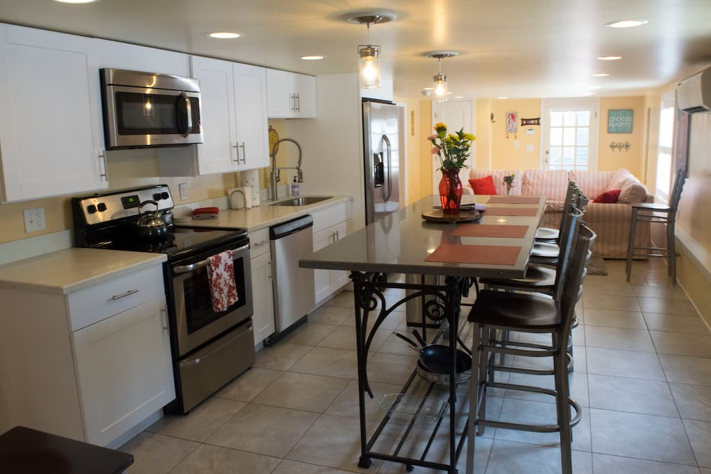 Open concept kitchen/dining/living space provides perfect layout for quality time together