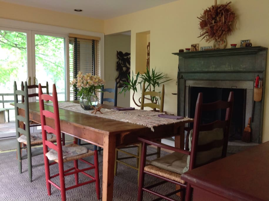Dining room with fire place that opens to screen porch, gas grille and two decks. Table seats 10.