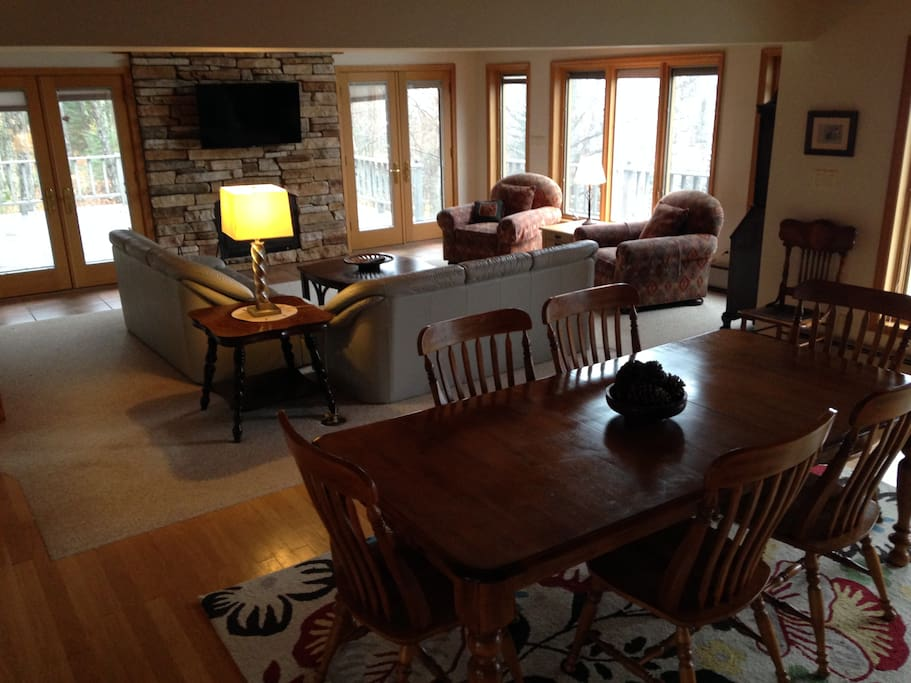 A spacious living room on the main floor, perfect for big gatherings, DirectTV and WiFi included.
