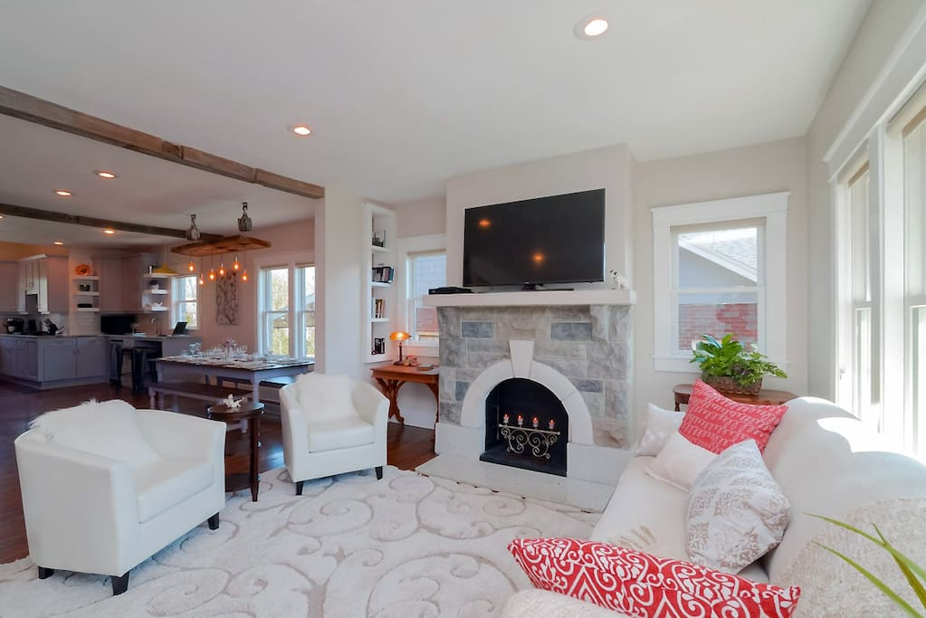 Gather on chic seating in the open concept living room area.