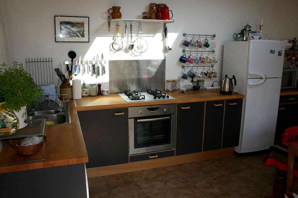 The remodeled, modern kitchen is fully equipped