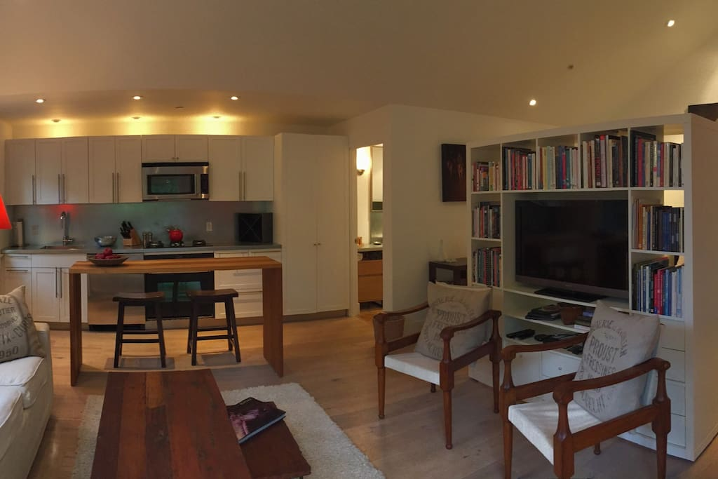 Living Room with Queen size Pull out Sofa, Custom Dining Table and Fully Equipped Kitchenette