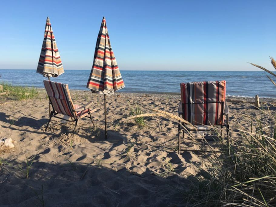 Beach chairs and parasols provided.