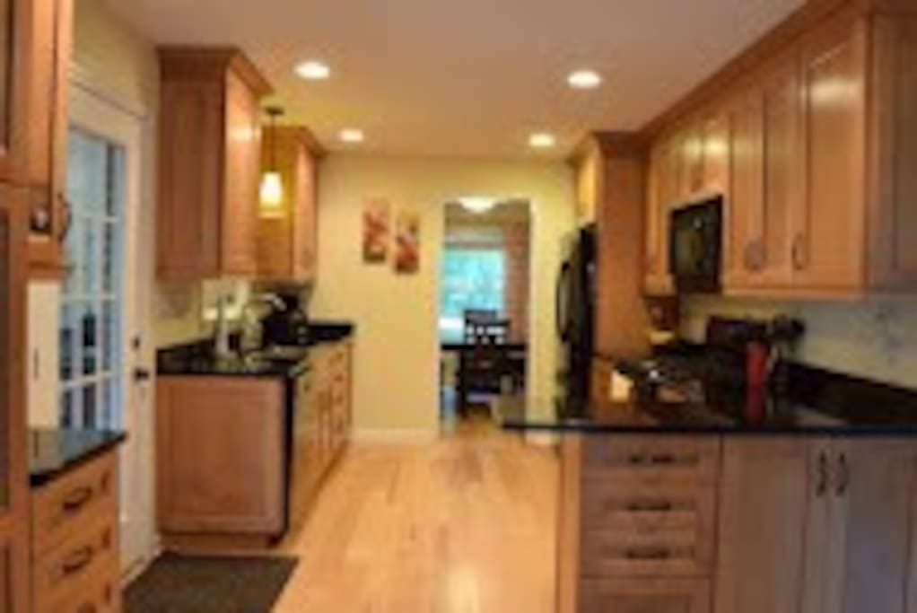 Updated kitchen, access to sunroom and dining room