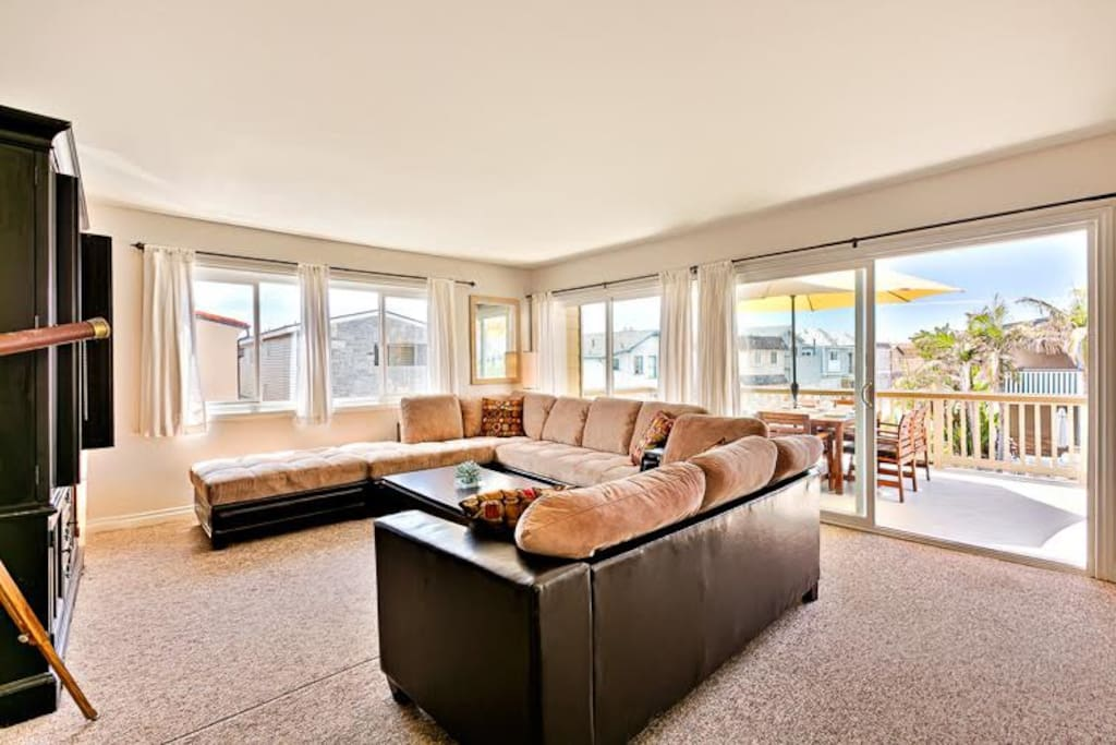 Great room with comfortable seating and an ocean view.