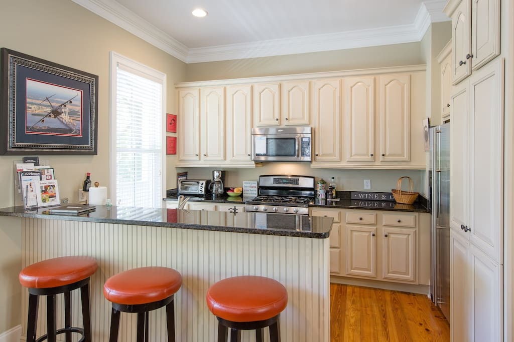 Barstools, granite countertops, and updated appliances