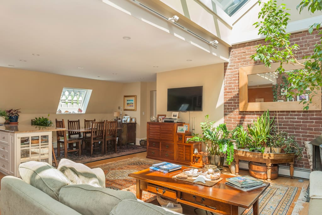 Living & Dining Room Beneath Gorgeous Skylight