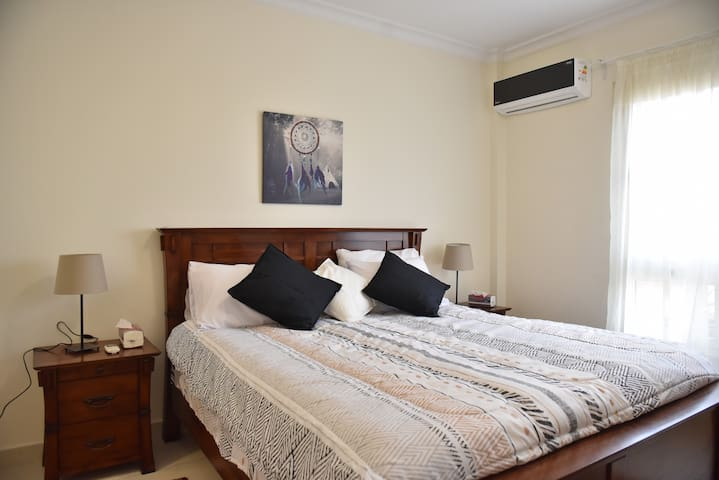 Master bedroom, offering king sized bed.  Room offers en suite, with pedestal sink/toilet/tub and shower