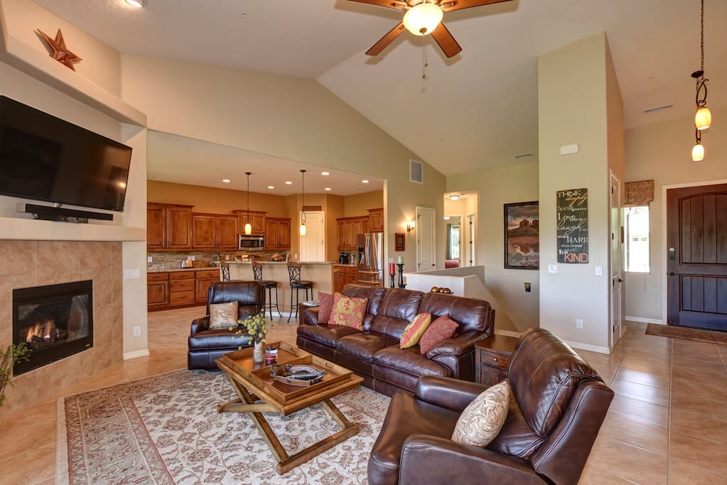"""Family Room with 60"""" Cable TV, Leather Sofa & Swivel Reclining Chairs"""