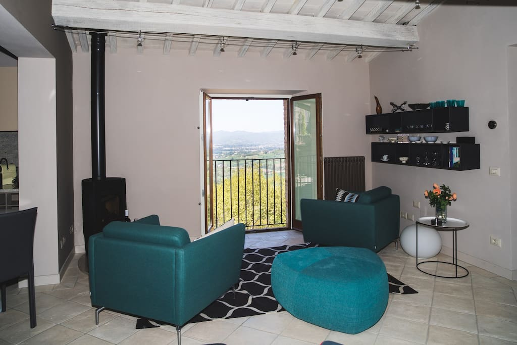 Lounge with Juliet balcony to view the stunning sunsets over the hills of Umbria -  a world away from the city