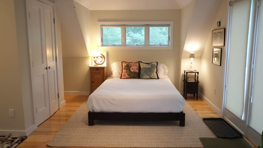 Bright airy bedroom with vaulted ceiling.