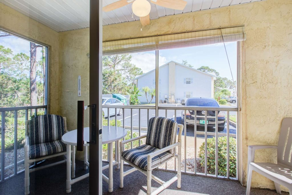 Enjoy breakfast in the morning on this quiet screened-in patio.