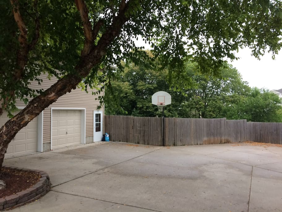 Parking area to right of b-ball hoop