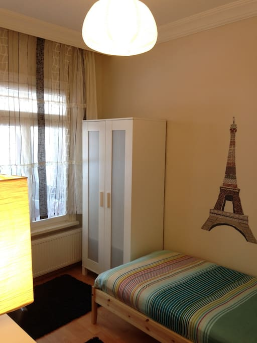 ROOM 203 is a single room having a single bed, wardrobe, desk, chair, floor lamp and bedside table. There is also a balcony in the room which is shared by Room 4, as well