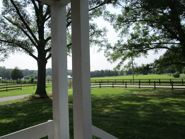 Beautiful views! Front Porch with benches.