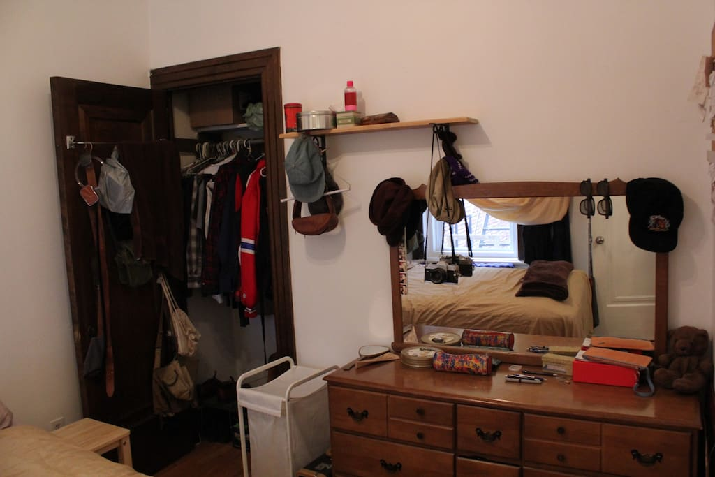 Room includes closet, dresser, laundry hamper and side tables. All personal items have been removed.