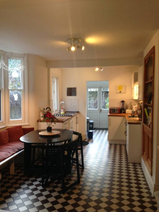 Large and endlessl sunny kitchen with utility room