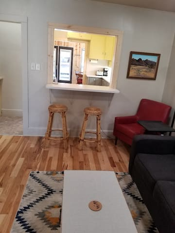From Living room/see thru bar to kitchen