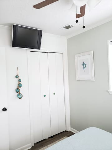 Master closet with shelving and hangers. You'll find extra linens, pillows, beach towels and toys here!