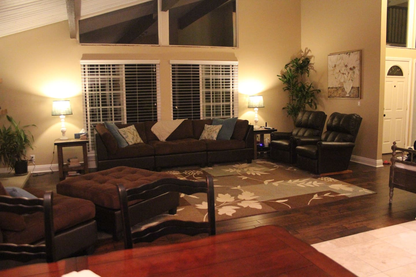 Large main living area with two recliners. Open to Kitchen and Dining room.